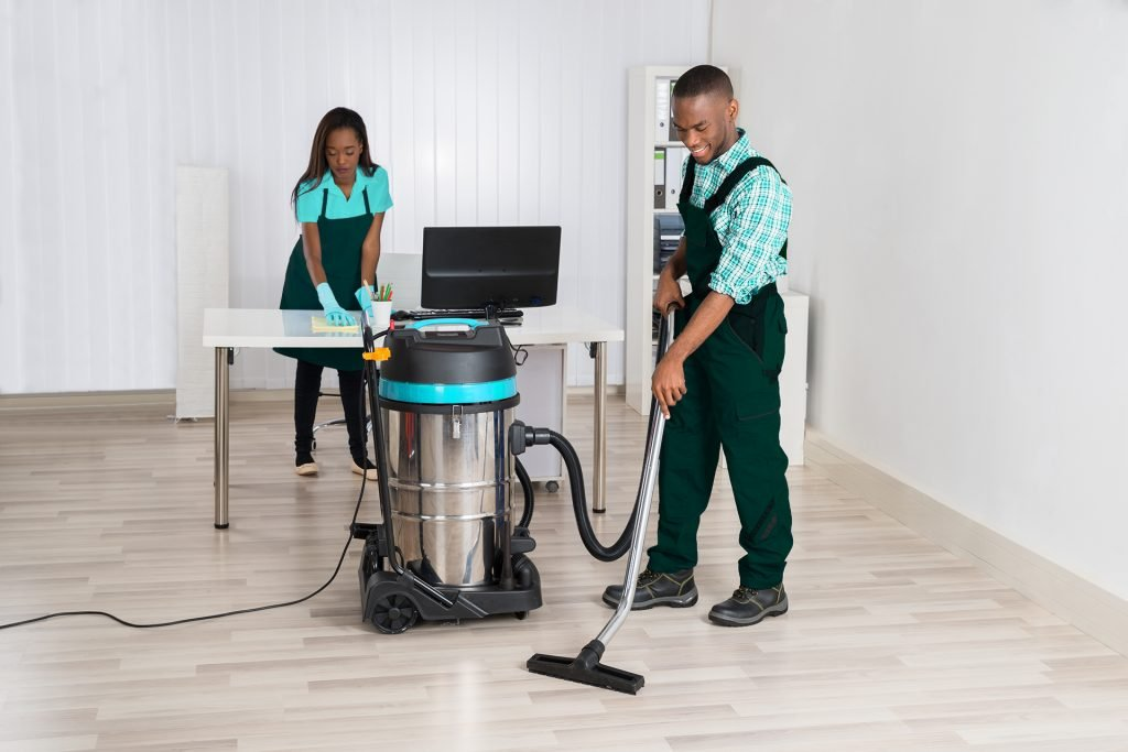 two people cleaning an office