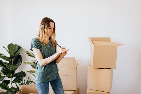 woman looking at moving checklist